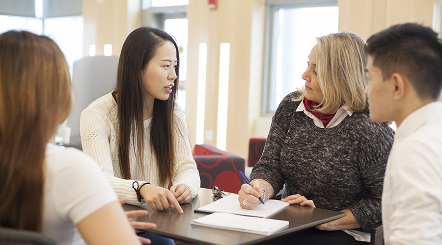 student talking to counselor