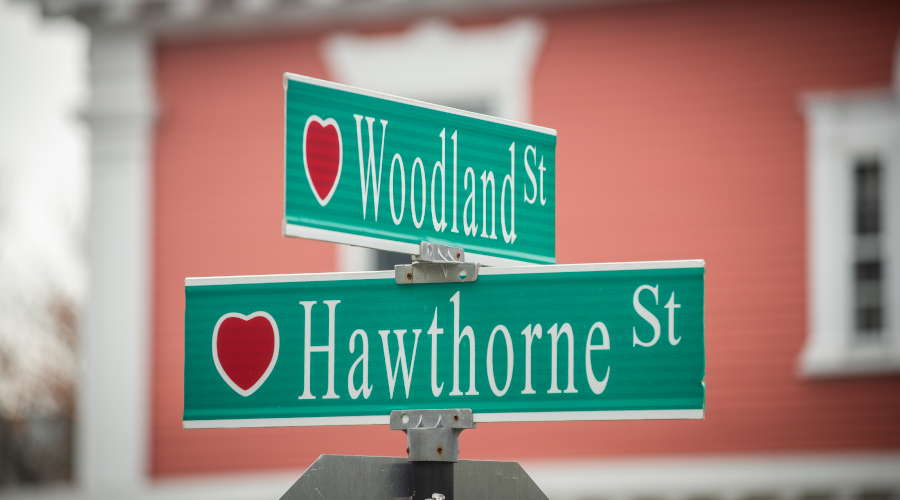 Hawthorne and Woodland Street signs