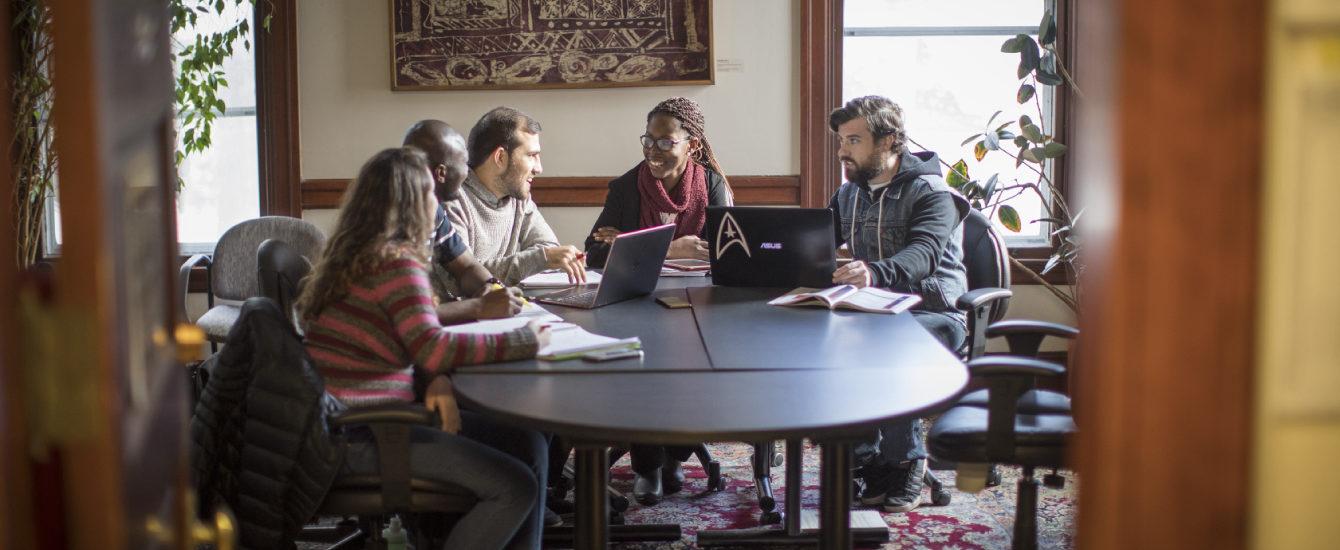 Graduate students conversing