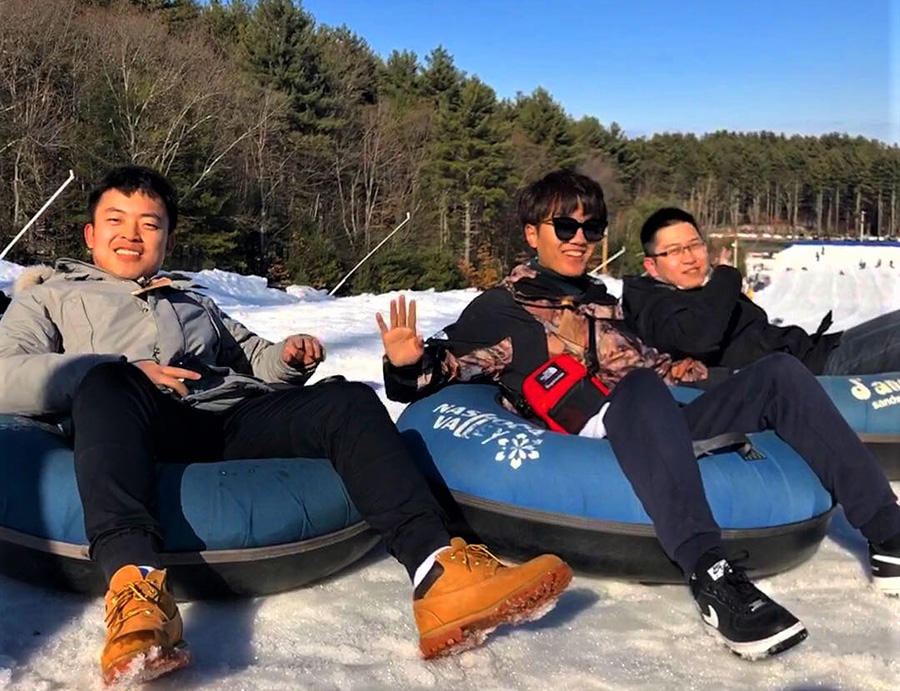 Students on snow tubes at Nashoba Valley