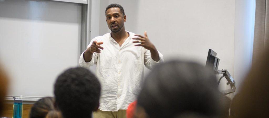 diversed teacher standing infront of class