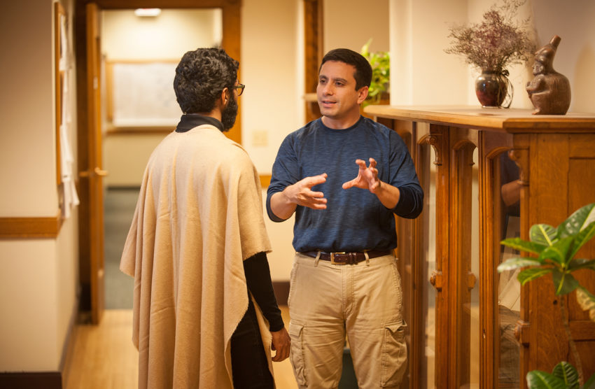 Faculty member talking to student