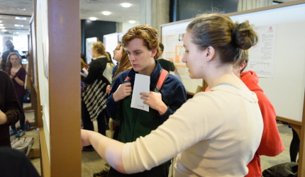 Student presenting project at fair