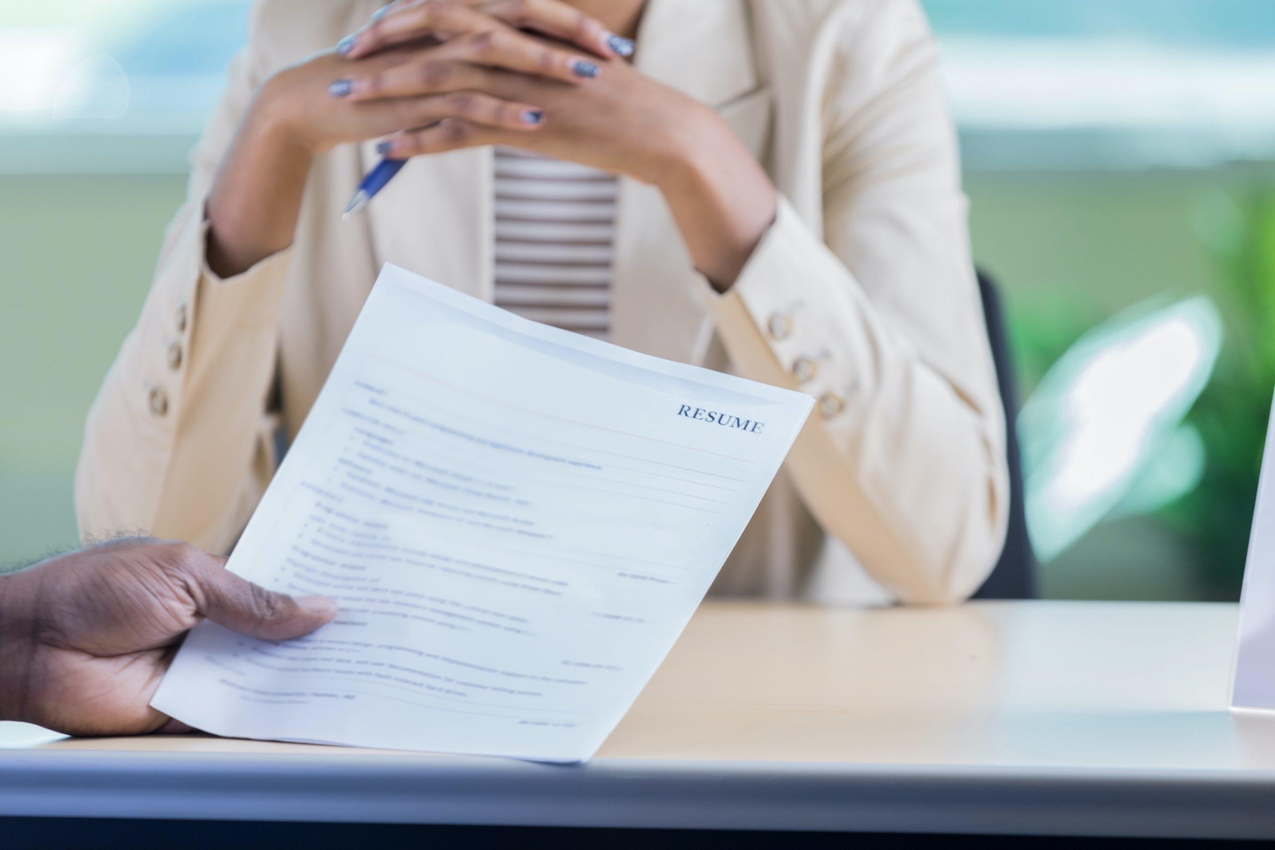 hands holding resume
