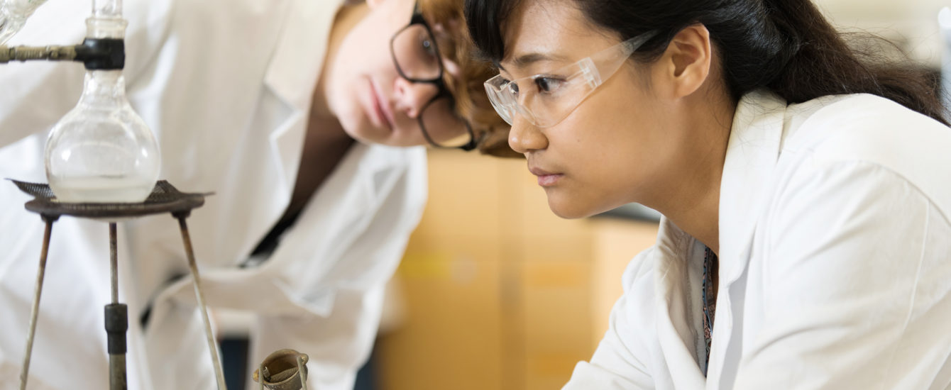 Female student looking through lab sco