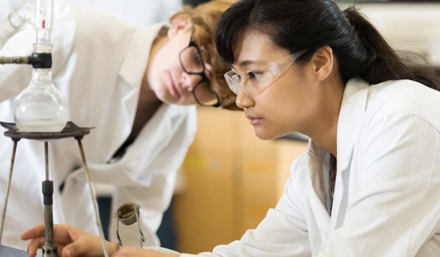 Female student looking through lab sco