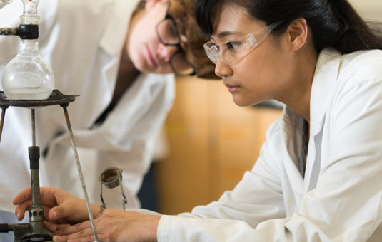 female students looking into scope