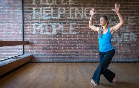 student posing in dance studio