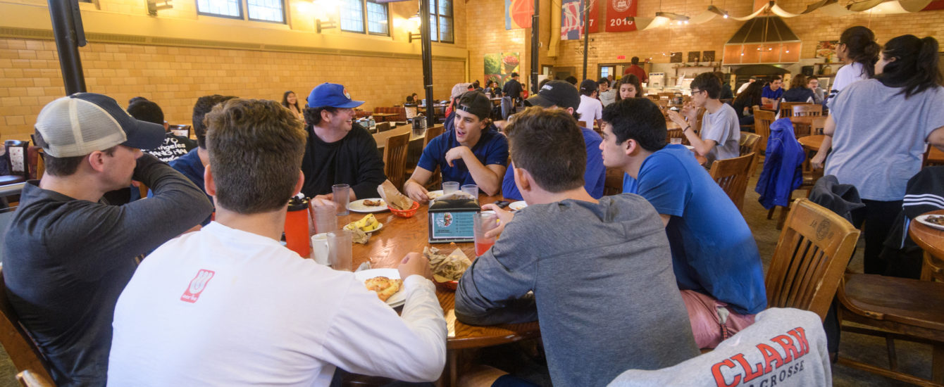 Students sitting around campus dining table