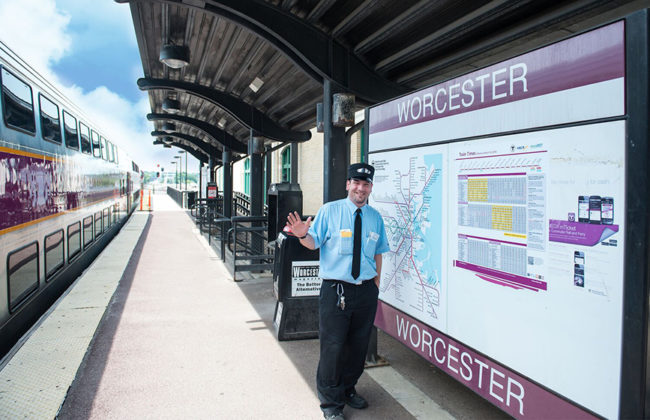 rail road worker standing in front of worcester rails map