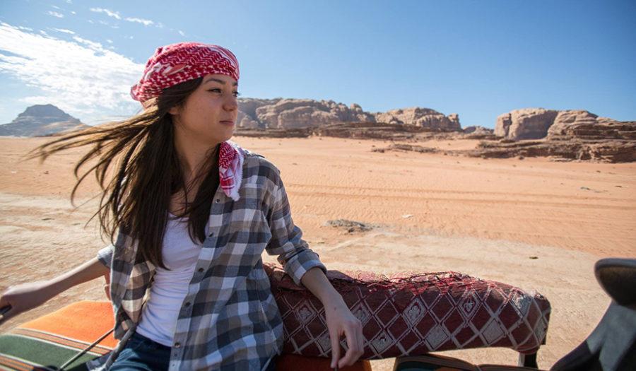 female student looking over desert