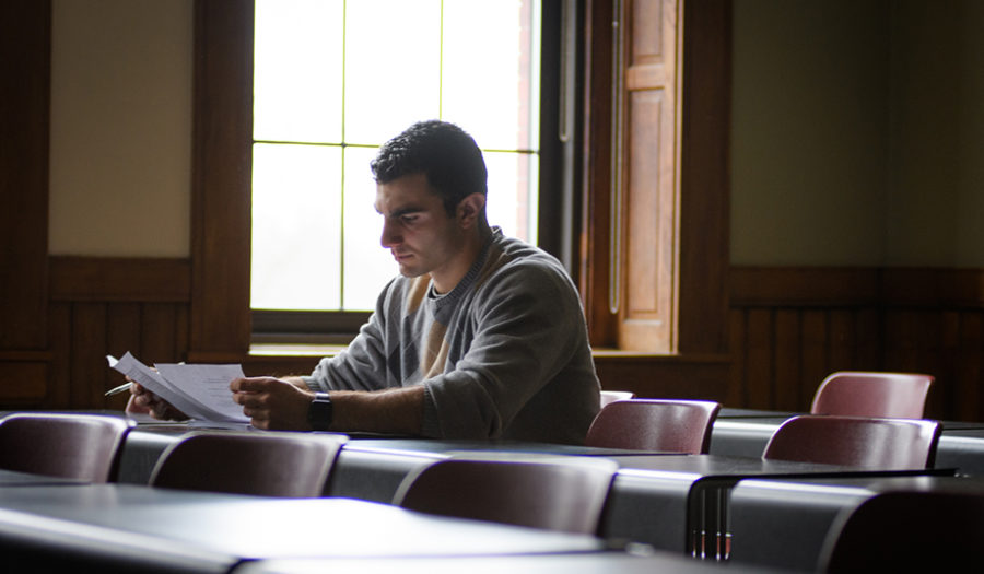 male student sitting at table