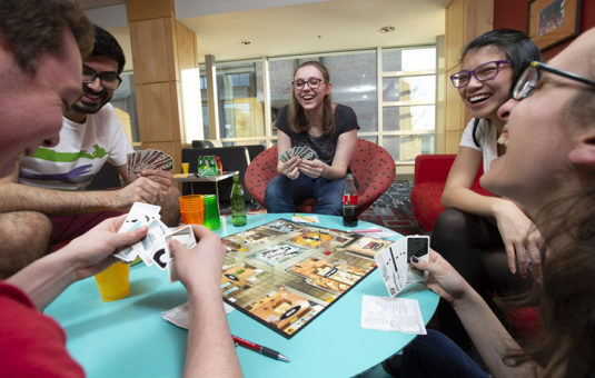 students playing game on table