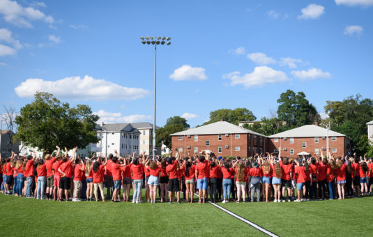 large group of students standing on field