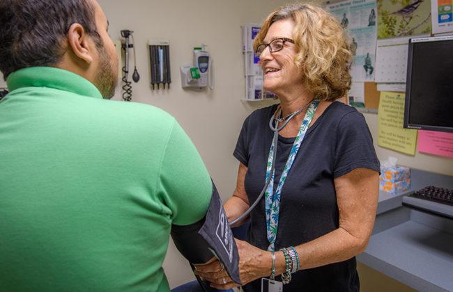 Nurse taking pressure of a studen