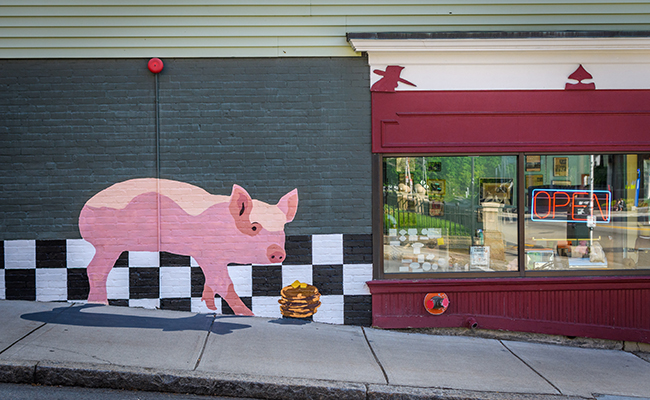 wall art on buiding of pig