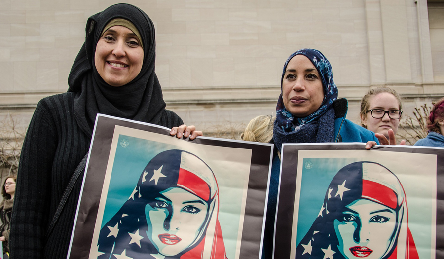 Muslim women carring posters