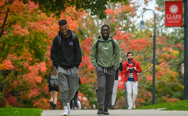fall foliage with student workers