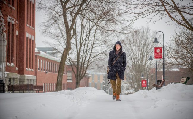 male student waking down snowy pa