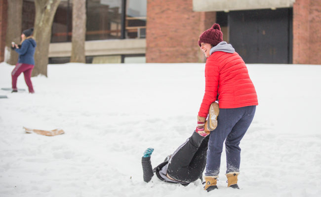 girl dragging male in snow