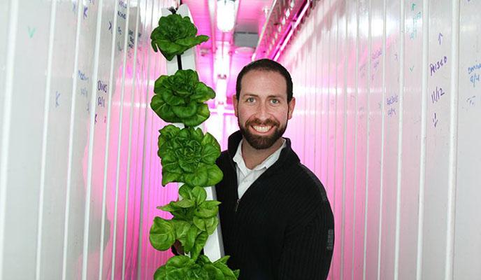 Brad McNamara with plant