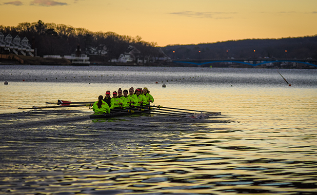 row crew on lake