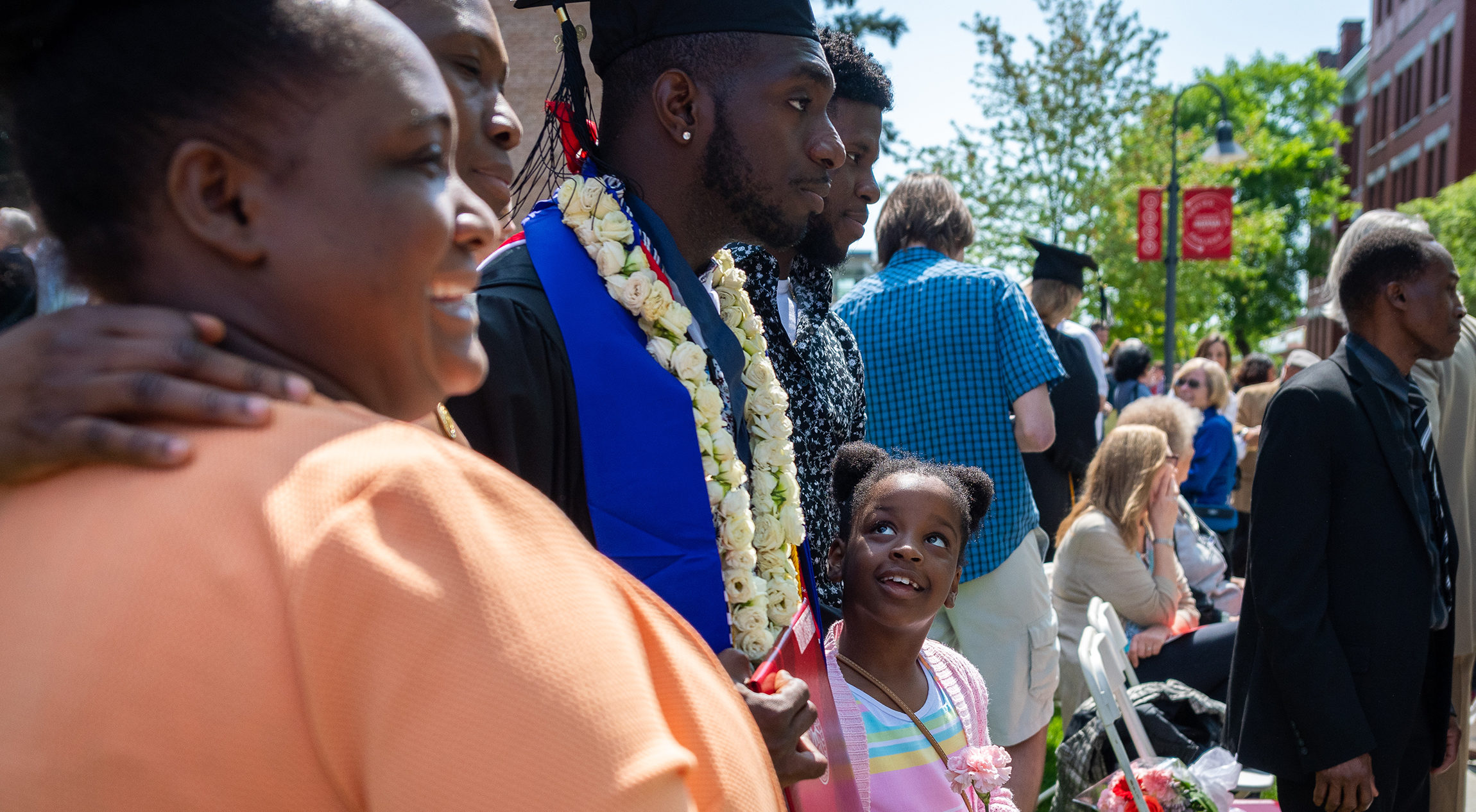 family celebrating commencement with son