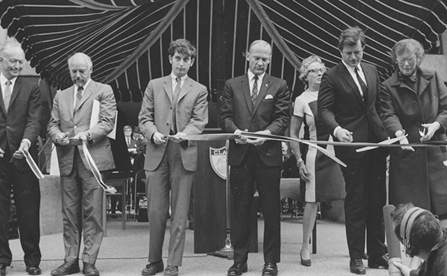 Buzz Aldren cutting ribbon at ceremony.