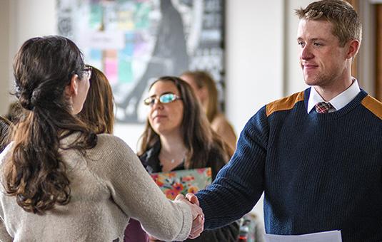 Student shaking hand of employer
