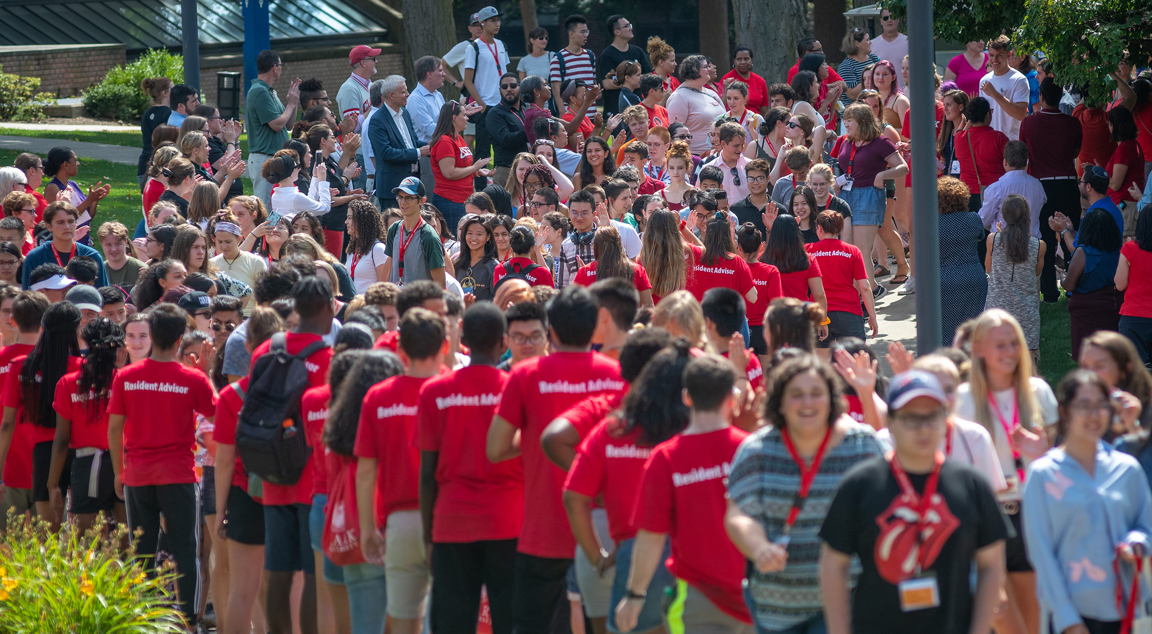 Students streaming through campus on move-in day at Clark University