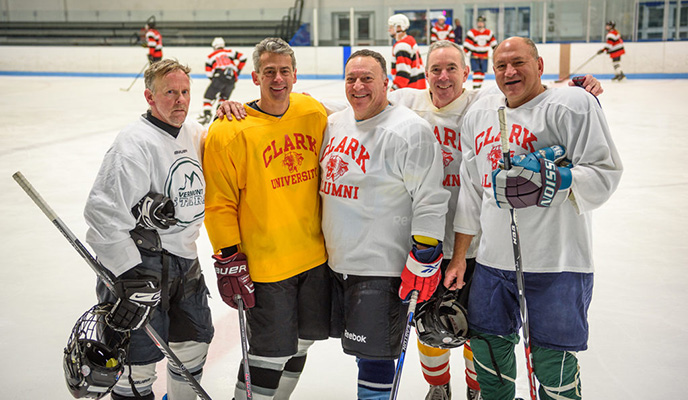 Alumni hockey players posed on ic
