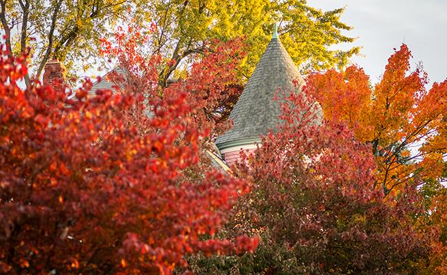 Alumni House with fall foliage