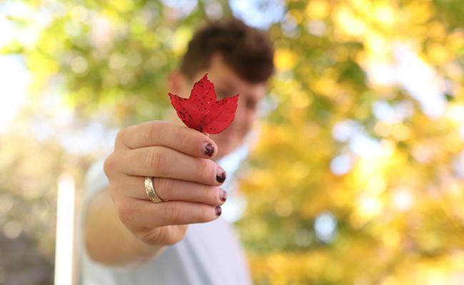 student holding up leaf