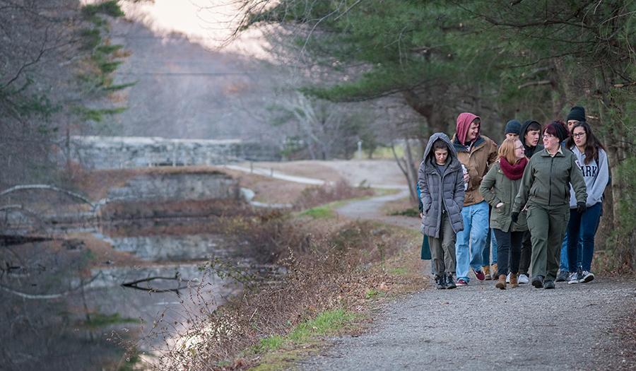 students walking beside river