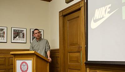 Alumnus at podium