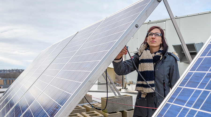 woman with solar panels