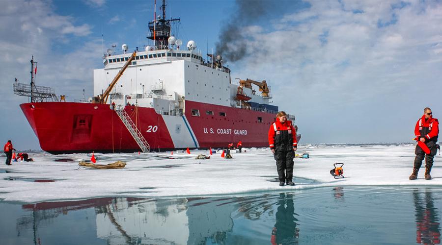 karen Frey on iceberg with ship in background