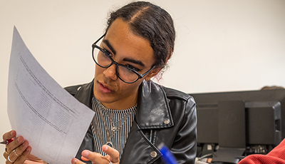 student looking at paper