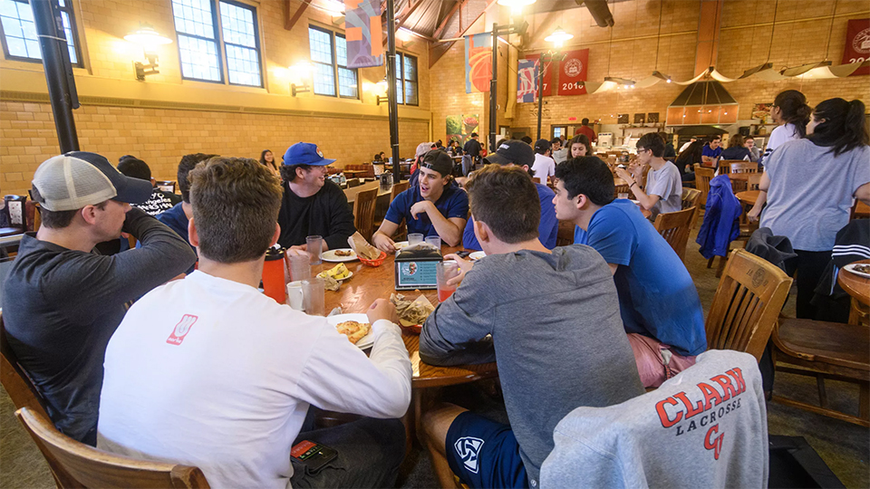 student sitting around dining hall