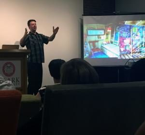 Diedricksen shows images of his building projects during a recent presentation at Clark.