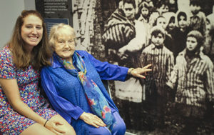 Casey Bush with Eva Kor, who points to a picture of her and her twin at Auschwitz