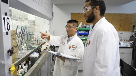 Above, Michael Kebede, right, works with Dr. Jia Wei, Ph.D. '15, a research scientist at PCI Synthesis.