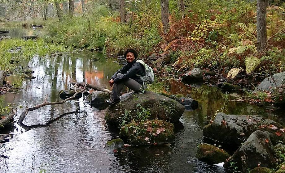 Olivia Barksdale sitting by stream
