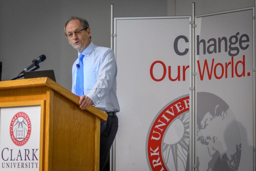 Sir Michael Marmot standing at podium