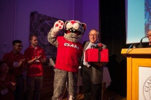 "The Clark Cougar leads the audience in a rendition of ""Happy Birthday"" for Peter Klein '64."