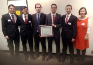 "The Clark University team captured third place in the 2015 Boston Regional College Fed Challenge, an ""intensely competitive"" contest held at the Federal Reserve Bank of Boston (Nov. 6). Pictured, from left, are Jorge Galvez Rodriguez, Rahul Dutt, Associate Professor of Economics David Cuberes, Doga Bilgin, Roei Shimony, and Assistant Professor of Economics Chang Hong."