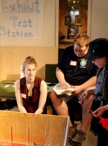 """Amanda Duquenoy '17 and Alex Merriam '17 observe a museum patron at the """"Maps as Models"""" exhibit prototype"""