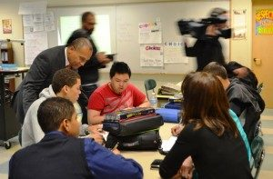 Gov. Deval Patrick visits with students at the Claremont Academy