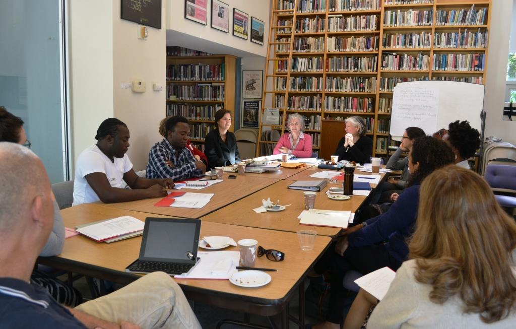 """Participants in the IDCE workshop """"Witnessing: Taking testimonies and constructing refugee narratives"""" (Sept. 19-21) gather in the Rose Library at the Strassler Center for Holocaust and Genocide Studies at Clark University. Leading the workshop are Leora Kahn and Anita Häusermann Fábos."""
