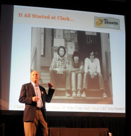 Ron Shaich next to slide photo